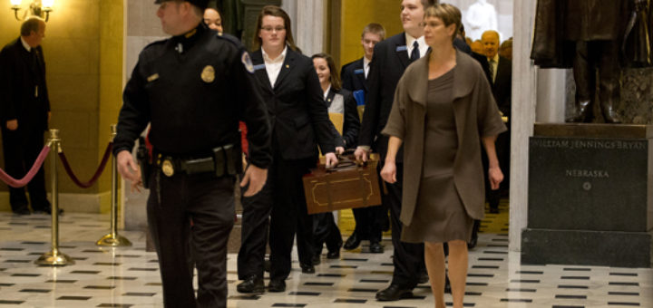 Pages lead a Senate procession carrying two boxes holding Electoral College votes through Statuary Hall to the House Chamber on Capitol Hill on Capitol Hill in Washington, Friday, Jan. 4, 2013. re-election.  (AP Photo/Jacquelyn Martin)