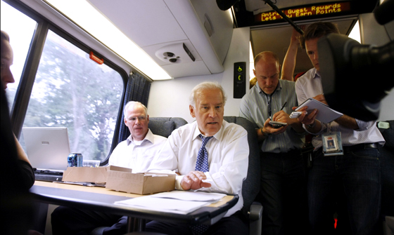 Then Sen. Joe Biden (D-Del) mingles with passengers aboard the Amtrak Acela train. (AP file photo/Gerald Herbert)